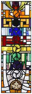 Planetary stained glass window designed by Nigel Pennick
