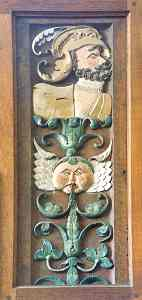 Green Man on one of several Jacobean panels from Bradfield House, made up to form a reredos in the Walfrond Chapel of St Mary the Virgin, Uffculme, Devon.